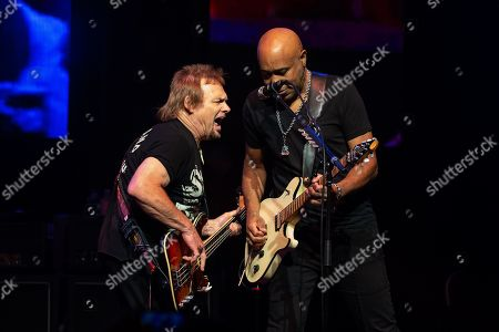(L-R) Musicians Michael Anthony and Vic Johnson perform in concert with Sammy Hagar and The Circle at ACL Live