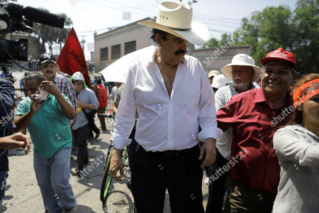 Stock Image of Honduras' former president Manuel Zelaya participate in a demonstration during the commemoration of the Labor Day in Tegucigalpa, Honduras, 01 May 2019. Thousand of Honduran workers march in the main cities of the country against the Honduras President Juan Orlando Hernandez and the privatization of health and education.