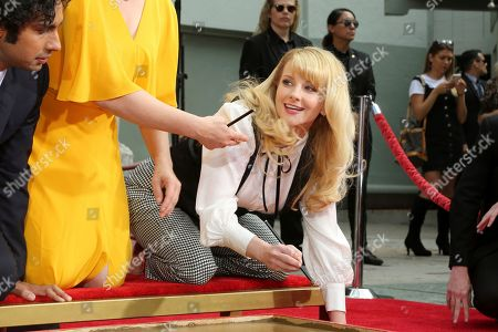 """Melissa Rauch, member of the cast of the TV series """"The Big Bang Theory,"""" signs in cement during a handprint ceremony at the TCL Chinese Theatre on at in Los Angeles"""