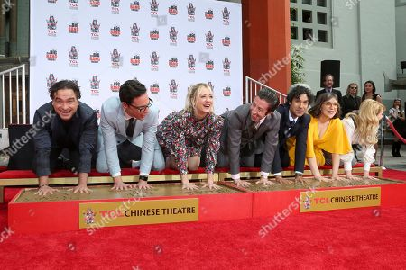 """Johnny Galecki, Jim Parsons, Kaley Cuoco, Simon Helberg, Kunal Nayyar, Mayim Bialik, Melissa Rauch. Johnny Galecki, from left, Jim Parsons, Kaley Cuoco, Simon Helberg, Kunal Nayyar, Mayim Bialik and Melissa Rauch, members of the cast of the TV series """"The Big Bang Theory,"""" place their hands in cement during a handprint ceremony at the TCL Chinese Theatre on at in Los Angeles"""