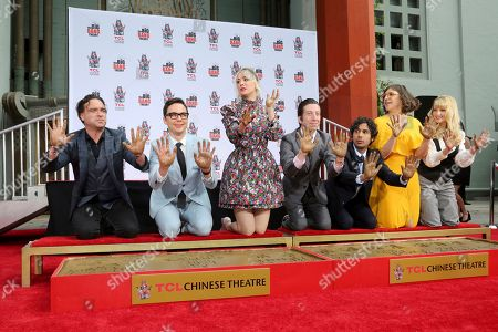 """Johnny Galecki, Jim Parsons, Kaley Cuoco, Simon Helberg, Kunal Nayyar, Mayim Bialik, Melissa Rauch. Johnny Galecki, from left, Jim Parsons, Kaley Cuoco, Simon Helberg, Kunal Nayyar, Mayim Bialik and Melissa Rauch members of the cast of the TV series """"The Big Bang Theory"""" show their hands after placing them in cement during a handprint ceremony at the TCL Chinese Theatre on at in Los Angeles"""