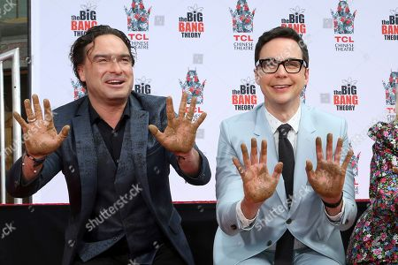 """Johnny Galecki, Jim Parsons, Kaley Cuoco, Simon Helberg, Kunal Nayyar, Mayim Bialik, Melissa Rauch. Johnny Galecki, left,and Jim Parsons, members of the cast of the TV series """"The Big Bang Theory"""" show their hands after placing them in cement during a handprint ceremony at the TCL Chinese Theatre on at in Los Angeles"""