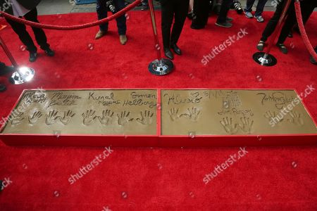 """Johnny Galecki, Jim Parsons, Kaley Cuoco, Simon Helberg, Kunal Nayyar, Mayim Bialik, Melissa Rauch. Detail of ther handprints in cement of Johnny Galecki, from right, Jim Parsons, Kaley Cuoco, Simon Helberg, Kunal Nayyar, Mayim Bialik and Melissa Rauch, members of the cast of the TV series """"The Big Bang Theory"""" following a handprint ceremony at the TCL Chinese Theatre on at in Los Angeles"""