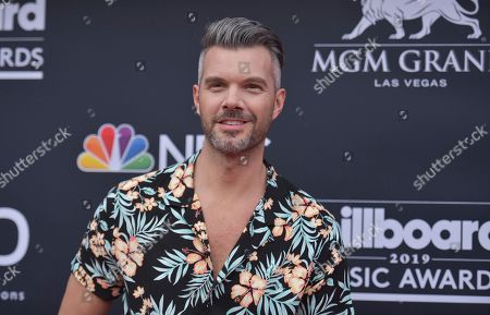 AJ Gibson arrives at the Billboard Music Awards, at the MGM Grand Garden Arena in Las Vegas