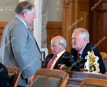 Stock Image of Dan Hawkins, Jan Kessinger. Kansas House Majority Leader Dan Hawkins, left, R-Wichita, talks to Rep. Jan Kessinger, R-Overland Park, right, after the House failed to override Democratic Gov. Laura Kelly's veto of an abortion bill, at the Statehouse in Topeka, Kansas. Kessinger is the only House Republican to vote against overriding the veto, and Hawkins and other GOP lawmakers were trying to get Kessinger to change his mind so that the House could take a second vote