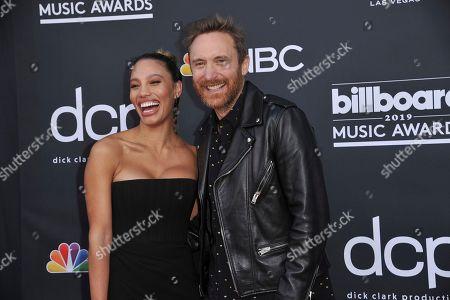 Stock Image of Jessica Ledon, David Guetta. Jessica Ledon, left, and David Guetta arrive at the Billboard Music Awards, at the MGM Grand Garden Arena in Las Vegas