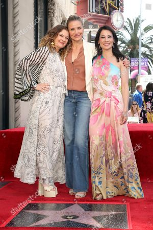 """Stock Image of Drew Barrymore, Cameron Diaz, Lucy Liu. Drew Barrymore, from left, Cameron Diaz and Lucy Liu, all members of the cast of """"Charlie's Angels"""" pose atop the star following a ceremony honoring Lucy Liu with a star at the Hollywood Walk of Fame, in Los Angeles"""