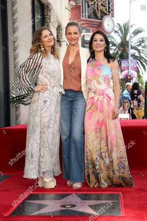 """Stock Photo of Drew Barrymore, Cameron Diaz, Lucy Liu. Drew Barrymore, from left, Cameron Diaz and Lucy Liu, all members of the cast of """"Charlie's Angels"""" pose atop the star following a ceremony honoring Lucy Liu with a star at the Hollywood Walk of Fame, in Los Angeles"""