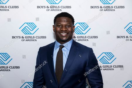 NFL Hall of Famer LaDainian Tomlinson walks the blue carpet at Boys & Girls Clubs of America's Alumni Hall of Fame ceremony today in Houston, Texas