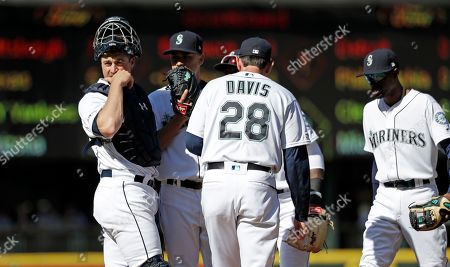 Paul Davis, Tom Murphy, Marco Gonzales. Seattle Mariners catcher Tom Murphy, left, looks back as he meets with starting pitcher Marco Gonzales, second left, and pitching coach Paul Davis on the mound after Gonzales gave up a run to the Chicago Cubs in the second inning of a baseball game, in Seattle