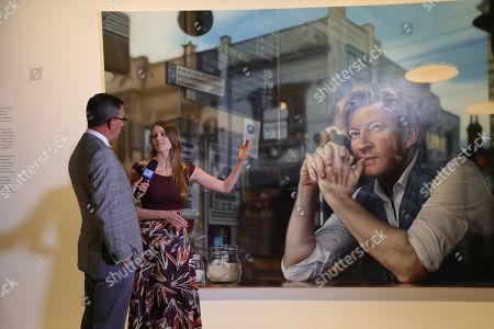 Perth artist Tessa MacKay next to her winning portrait of renowned actor and producer David Wenham.