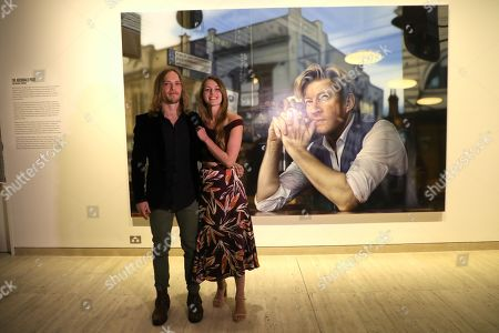 Perth artist Tessa MacKay and husband Roderick MacKay pose next to her winning portrait of renowned actor and producer David Wenham.