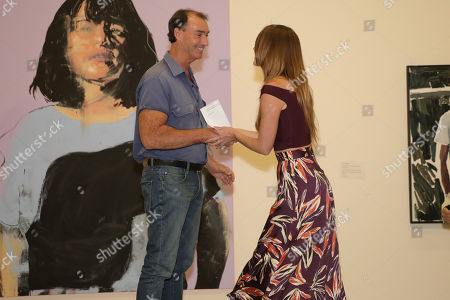 Perth artist Tessa MacKay shakes hands with Art Gallery of New South Wales head packer Brett Cuthbertson after he announces her as the winner of the 2019 Archibald Packing Room Prize for her portrait of renowned actor and producer David Wenham.