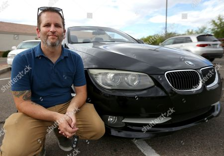 Chris Williamson poses for a photo sitting next to his car in Phoenix. When Williamson was in the market for a new family car, a timely ad and conversations with a co-worker convinced him to try something out of the ordinary. He bought the BMW 3 Series convertible and covers the payments by renting it to strangers on a peer-to-peer car sharing app called Turo. It allows his family of seven to have a nicer car, essentially for free