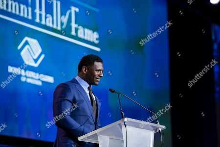 NFL Hall of Famer LaDainian Tomlinson speaks at his induction ceremony for Boys & Girls Clubs of America's Alumni Hall of Fame on in Houston