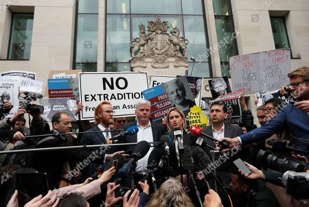 Kristinn Hrafnsson, Editor-in-chief of WikiLeaks and barrister Jennifer Robinson, centre, address the media at Westminster Magistrate Court in London,. WikiLeaks founder Julian Assange is facing court over a U.S. request to extradite him for alleged computer hacking