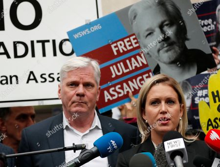 Kristinn Hrafnsson, Editor-in-chief of WikiLeaks and barrister Jennifer Robinson, right, address the media outside Westminster Magistrate Court in London,. WikiLeaks founder Julian Assange, seen in poster behind, is facing court over a U.S. request to extradite him for alleged computer hacking