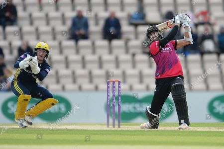 Stock Image of David Wiese of Sussex hits a six off the bowling of Mason Crane  during the Royal London One Day Cup match between Hampshire County Cricket Club and Sussex County Cricket Club at the Ageas Bowl, Southampton