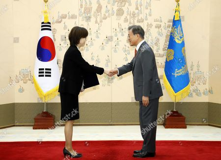 Stock Picture of South Korean President Moon Jae-in (R) shakes hands with Lee Mi-sun (L) after giving her a letter of appointment as a judge at Constitutional Court, in Seoul, South Korea, 25 April 2019.