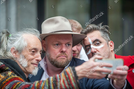 Ben Westwood (left) at the Extinction Rebellion 'Carn-evil of Chaos' Fashion Parade at the Brazillian Embassy to show solidarity with the people of Brazil and their eco system.