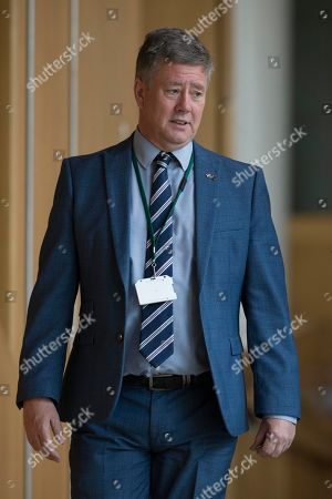Scottish Parliament First Minister's Questions - Keith Brown, Cabinet Secretary for Economy, Jobs and Fair Work, and Deputy Leader of the Scottish National Party (SNP), makes his way to the Debating Chamber.