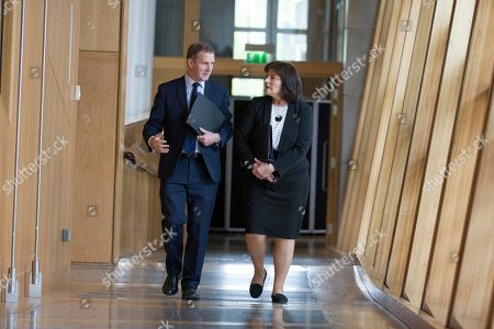Scottish Parliament First Minister's Questions - Michael Matheson, Cabinet Secretary for Transport, Infrastructure and Connectivity, and Jeane Freeman, Cabinet Secretary for Health and Sport, make their way to the Debating Chamber