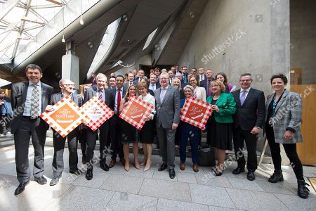 Stock Photo of The Great Get Together photocall at The Scottish Parliament - Kim Leadbeater, sister of the murdered MP Jo Cox, with MSPs including  Ken Macintosh, The Presiding Officer of The Scottish Parliament, Patrick Harvie, Co-convener of the Scottish Greens, Willie Rennie, Leader of the Scottish Liberal Democrats, Anas Sarwar (Scottish Labour and sponsor of the photocall), Nicola Sturgeon, First Minister of Scotland and Leader of the Scottish National Party (SNP), Jackson Carlaw, acting Leader of the Scottish Conservative and Unionist Party, Annie Wells (Scottish Conservative and Unionist Party), Annabelle Ewing (SNP), Derek Mackay, Cabinet Secretary for Finance, Economy and Fair Work, and Mairi Gougeon (SNP)