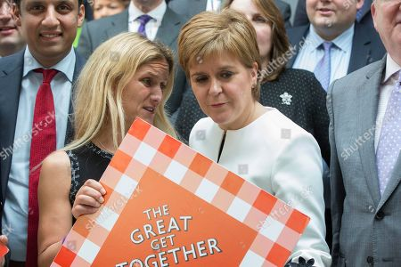 Stock Image of The Great Get Together photocall at The Scottish Parliament - Anas Sarwar (Scottish Labour and sponsor of the photocall), Kim Leadbeater, sister of the murdered MP Jo Cox, and Nicola Sturgeon, First Minister of Scotland and Leader of the Scottish National Party (SNP)