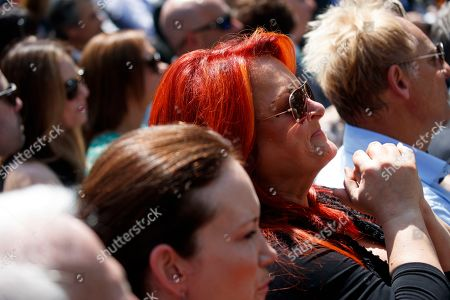 Musician Wynonna Judd listens as President Donald Trump speaks during a National Day of Prayer event in the Rose Garden of the White House, in Washington