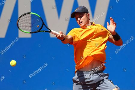 Stock Picture of Rudolf Molleker of Germany returns the ball to Roberto Bautista Agut of Spain during his round of sixteen match at the ATP tennis tournament in Munich, Germany