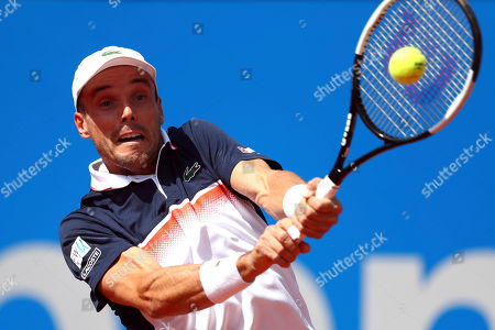 Stock Photo of Roberto Bautista Agut of Spain returns the ball to Rudolf Molleker of Germany during his round of sixteen match at the ATP tennis tournament in Munich, Germany