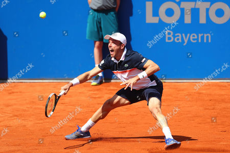 Stock Image of Roberto Bautista Agut of Spain watches the ball as he returns to Rudolf Molleker of Germany during his round of sixteen match at the ATP tennis tournament in Munich, Germany