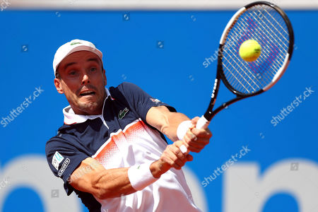 Roberto Bautista Agut of Spain returns the ball to Rudolf Molleker of Germany during his round of sixteen match at the ATP tennis tournament in Munich, Germany
