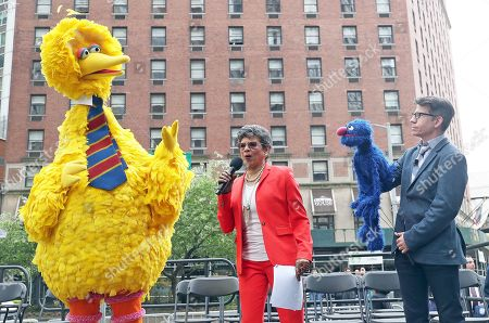 Big Bird and Grover, Muppets from Sesame Street along with (Center) Sonia Manzano attend a street renaming ceremony in New York City