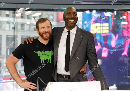Ethan Brown, left, CEO of Beyond Meat, attends the Opening Bell ceremony with former NBA basketball player John Salley to celebrate the company's IPO at Nasdaq, in New York. California-based Beyond Meat makes burgers and sausages out of pea protein and other ingredients. Salley is a professed vegan