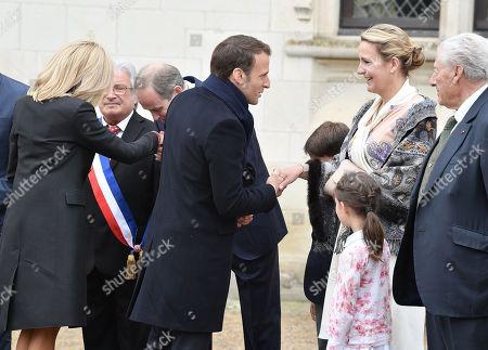 Stock Picture of Prince Henri d'Orleans, Jean of Orleans, Micaela Cousino Quinones de Leon, Princess Philomena d'Orleans and their children, Prince Gaston d'Orleans and Princess Antoinette d'Orleans welcome French President Emmanuel Macron and his wife Brigitte Trogneux before a ceremony to commemorate the 500th anniversary of the death of Italian renaissance painter and scientist Leonardo da Vinci at the Chateau d'Amboise