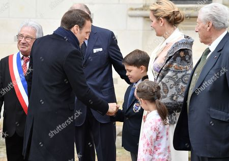Prince Henri d'Orleans, Jean of Orleans, Micaela Cousino Quinones de Leon, Princess Philomena d'Orleans and their children, Prince Gaston d'Orleans and Princess Antoinette d'Orleans welcome French President Emmanuel Macron and his wife Brigitte Trogneux before a ceremony to commemorate the 500th anniversary of the death of Italian renaissance painter and scientist Leonardo da Vinci at the Chateau d'Amboise