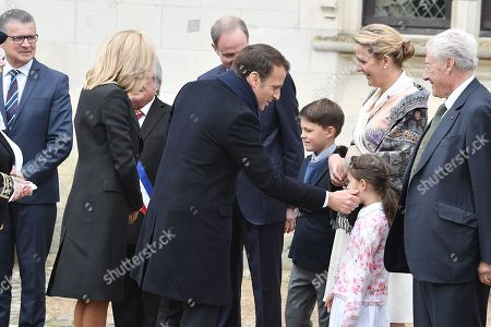 Stock Picture of Prince Henri d'Orleans, Jean of Orleans, Micaela Cousino Quinones de Leon, Princess Philomena d'Orleans and their children, Prince Gaston d'Orleans and Princess Antoinette d'Orleans welcome French President Emmanuel Macron and his wife Brigitte Trogneux