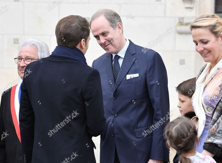 Prince Henri d'Orleans, Jean of Orleans welcomes French President Emmanuel Macron before a ceremony to commemorate the 500th anniversary of the death of Italian renaissance painter and scientist Leonardo da Vinci at the Chateau d'Amboise on May