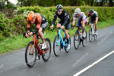 Charles, Daniel Bigham of Ribble Pro Cycling Team, Sean Flynn of Great Britain Cycling Team and Kevin Vermaerke of Team Hagens Berman Axeon ride in the breakaway.