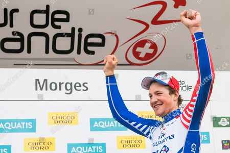 The winner of the stage Stefan Kueng from Switzerland of team Groupama-FDJ celebrates on the podium during the second stage, a 174,4 km race between Le Locle and Morges at the 73th Tour de Romandie UCI ProTour cycling race in Morges, Switzerland, 02 May 2019.