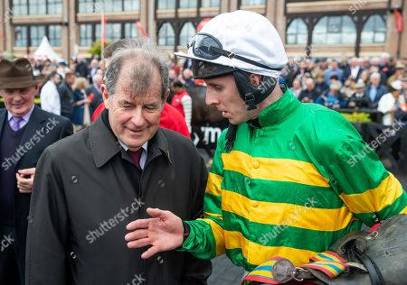 Mark Walsh chats to owner JP McManus after winning The Ladbrokes Champion Stayers Hurdle on Uknowwhatimeanharry