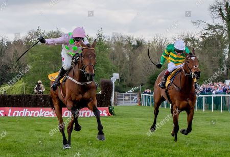 Stock Image of Richard Johnson in second place on Defi Du Seuil trails eventual winner Robbie Power on Chacun Pour Soi in The Ryanair Novice Steeplechase