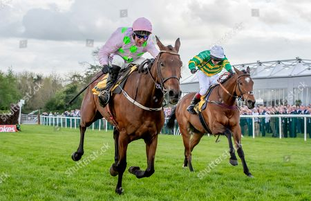 Richard Johnson in second place on Defi Du Seuil trails eventual winner Robbie Power on Chacun Pour Soi in The Ryanair Novice Steeplechase