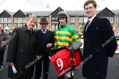 PUNCHESTOWN. UNOWHATIMEANHARRY and Mark Walsh won for trainer Harry Fry (right), owner JP McMANUS (left) and FRANK BERRY (Racing Manager)