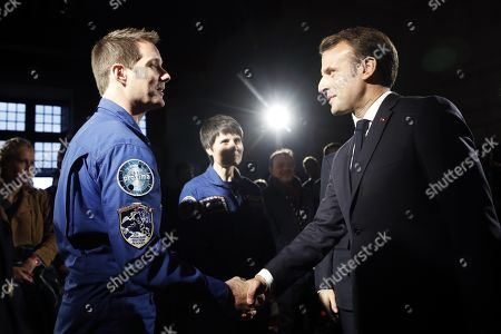 French President Emmanuel Macron (R) greets French astronaut Thomas Pesquet (L) and Italian astronaut Samantha Cristoforetti (R) during a commemoration of the 500th anniversary of the death of Italian Renaissance painter and scientist Leonardo da Vinci at the Chambord Castle, in Chambord, France, 02 May 2019.