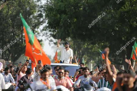 Bollywood actor and India's ruling Bharatiya Janata Party (BJP) candidate Sunny Deol waves to the crowd during an election campaign road show at Dinanagar in northern state of Punjab, India, . Indian Prime Minister Narendra Modi's BJP is facing a major test as it looks to govern for another five years after winning a clear majority in the 2014 election