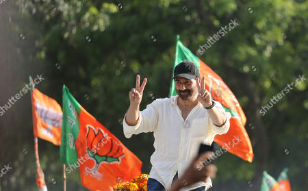 Bollywood actor and India's ruling Bharatiya Janata Party (BJP) candidate Sunny Deol gestures to the crowd during an election campaign road show at Dinanagar in northern state of Punjab, India, . Indian Prime Minister Narendra Modi's BJP is facing a major test as it looks to govern for another five years after winning a clear majority in the 2014 election