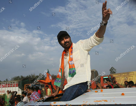 Bollywood actor and India's ruling Bharatiya Janata Party (BJP) candidate Sunny Deol greets people during an election campaign road show at Dinanagar in northern state of Punjab, India, . Indian Prime Minister Narendra Modi's BJP is facing a major test as it looks to govern for another five years after winning a clear majority in the 2014 election