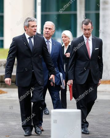 Mickael Behn, Javier Garcia-Bengochea, Bob Martinez. Mickael Behn, left, and Javier Garcia-Bengochea, right, walk out of federal court with attorney Bob Martinez, center, after filing lawsuits against Carnival Cruise Line, which has been using their former properties in Cuba, in Miami. Behn and Garcia-Bengochea, are the heirs of families that owned ports in Havana and Santiago de Cuba now being used to dock cruise ships that began traveling to Cuba in 2016 under President Barack Obama's detente with the island